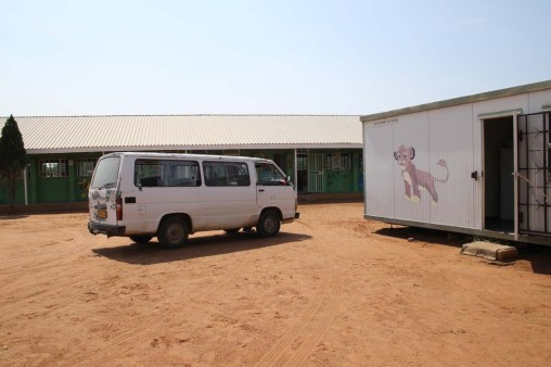 One of two transport vans with kitchen to the right